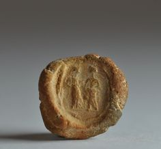 Roman bulla with two standing figures facing, 1st century B.C.-3rd century A.D. Private collection
