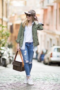 Exploring Rome: olive utility jacket with white tee and chambray shirt, AG Jeans distressed denim, Adidas 'Stan Smith' sneakers, vintage Louis Vuitton bag, how to layers with a utility jacket, casual outfit with utility jacket