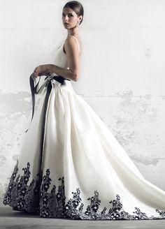 Long white ballgown with black trim at hem. Elegant.