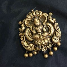 Indian gold jewellery designs- Antique Lakshmi pendant in gold