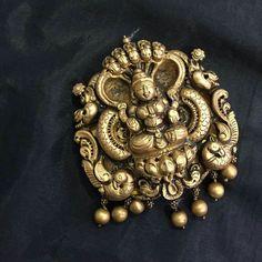 Indian gold jewellery designs- Antique Lakshmi pendant in gold