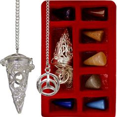 Cage Pendulum Set with 7 Chakras Stones Triple Moon - This distinctive silver toned pendulum features a Triple Moon designed cage which holds the chakra stone of your choice. Each pendulum set includes: A cage pendulum, 7 interchangeable semi-precious stones for each chakra.