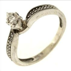 2 Gram 10kt White Gold Ring With Diamond Accents  http://www.propertyroom.com/l/2-gram-10kt-white-gold-ring-with-diamond-accents/9429701