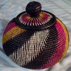 "This basket measures 8"" with the top. and has a 26"" circumference. This weave is relatively new among the Wounaan Embera basket weavers. The quality of this style basket has skyrocketed. I love the co"