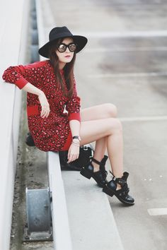 Andy Torres wearing a Kenzo leopard dress and Balenciaga boots