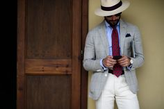 Panama Hat, striped shirt, checked sport coat, off white slacks and printed red tie