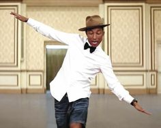 Pharrell Williams.. greatest mens style... need a black bow tie... white sleeveless button up and cut offs for the summer. love it!