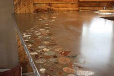 Concrete countertop http://evergreencaststone.com/wp-content/uploads/2011/11/0011-610x406.jpg