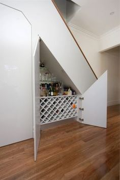 Wine Bar Under Stairs... Clever!