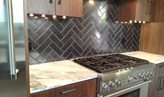 kitchen tiles...love this pattern, but thinking i want to use glass subway styled tiles.