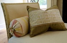 Vintage ribbon from France was used to make the rosette on the striped pillow.