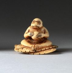 Girl on Turtle with Pig Offer Peach,Take it Japanese Ivory colored Bone netsuke