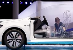 A cutaway model of the new e-Golf by car manufacturer Volkswagen, VW, is being cleaned by an employee at the Frankfurt Auto Show, IAA, in Frankfurt, Germany,
