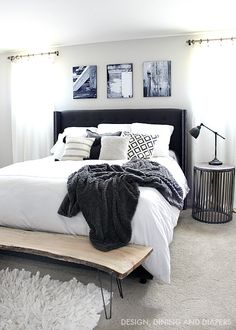 Black and White Master Bedroom with Wood accents