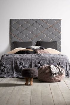 The most amazing knitted blanket on this bed. It must weigh a ton! 45 Cool Headboard Ideas To Improve Your Bedroom Design | room ideas home decor decorating ideas