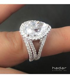 Stunning split-shank, pear brilliant diamond halo engagement ring by HadarDiamonds.com ~ Set with a 1.63 ct center laser drilled diamond.  Inquire for custom fitting. #loveit