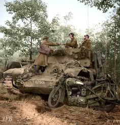 """An 11th Armoured Division """"DR"""" delivers a message to a Cromwell tank commander, Helmond, Netherlands."""