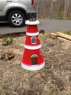 Lighthouse from clay pots. The top is a solar light!