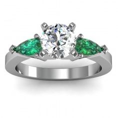 Classic Pear Shaped Emerald Diamond Engagement Ring set in 18k White Gold