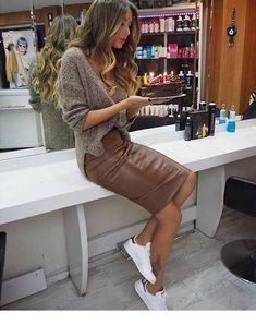 Brown veggie leather pencil skirt paired with oversized knit sweater and white sneakers for comfy yet stylish look. Mode Outfits, Fall Outfits, Casual Outfits, Dress Casual, Sneakers Fashion Outfits, Black Outfits, Party Outfits, Jean Outfits, Winter Trends