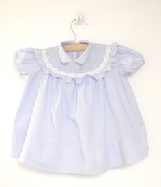 ≈Description≈  This is a beautiful Saks Fifth Avenue powder blue dress with white lace from the 1950s. The dress has a small round collar and short