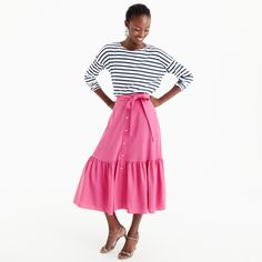 This lightweight Italian wool skirt in bright begonia adds the perfect pop to any outfit. Sits at waist. 31 long.Falls below knee. Wool. Dry clean. Import. Select stores.