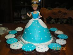 sarascakecreations: Cinderella barbie with cupcakes - Cinderella barbie cake... her skirt is all cake covered in buttercream then her bodice and skirt accents are fondant. star cup cakes to match. via Cake Central