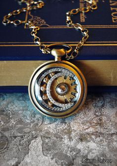 Moon Necklace - Moon Potion Steampunk Necklace - Pocket Watch Pendant with Silver Moon and Gold Stars. $62.00, via Etsy.