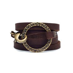 Wrap Bracelet Brass Chocolate - Stone + Smith designer Melissa Lynn begins construction with a full cowhide locally sourced in Austin, Texas. Breaking the hide down into thin strips, Lynn creates high-quality leather wrap bracelets. This one coils around the wrist five times and comes together with an antique finding and an oversized clasp. Mixing western style with some Rock n' Roll rebelliousness, this piece proves that things are better a little rough around the edges.