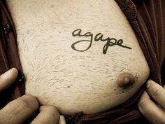 I know this is on a mans chest but i REALLY want this agape tattoo on my foot <3 Luv the font!