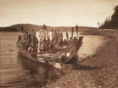Native American photographs A Kwakiutwl wedding party arrives on shore in canoes, in 1914. Edward Curtis