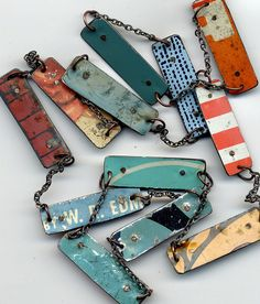 Recycled pieces of tins. Tin Tag Necklace by Fofum Studio on Etsy.