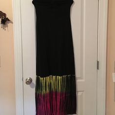 Roxy Maxi Dress, Size S, Pink/Yellow Stripe Design Strapless/ Halter top Maxi Dress made by Roxy. It is a size S but stretchy material. Has a string to turn into a halter top but can be worn strapless. It is all black except for the bottom where there is a tie dye-striped design of pink and yellow. It's comfortable, cute, and great for summer! Roxy Dresses Maxi