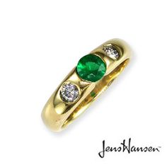 JENS HANSEN Round Natural Emerald set in 18ct yellow gold complemented by two side diamonds.