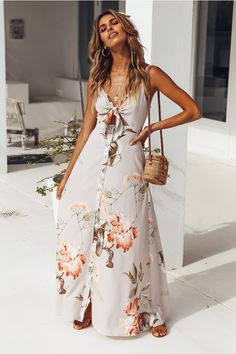We're really into maxis at the moment and our Sounds Of Summer Maxi Dress has our hearts racing! This style has a tie front bust, adjustable shoulder straps and it buttons down the front. This style looks street style chic when layered over a white tee an Beige Dresses, Casual Dresses, Fashion Dresses, Maxi Dress Wedding, Floral Maxi Dress, Beach Wedding Outfit Guest, Elegant Maxi Dress, Summer Dress Outfits, Summer Dresses For Women