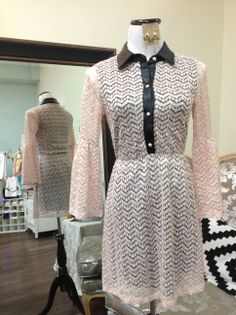 Lace dress with leather collar and trim.   https://www.facebook.com/photo.php?fbid=583985411673218&set=a.583985395006553.1073741968.385504891521272&type=1&permPage=1