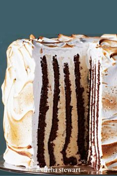 Looking for a dessert to impress? This extravagant eggnog meringue frosted creation features layers of génoise (sponge cake) alternated with a nutmeg-and-rum-scented semifreddo. In a unique twist, the layers are vertical instead of horizontal. #marthastewartliving #holidaydessert #easydessertrecipe #easyrecipes Gingerbread Cheesecake, Meringue Frosting, Cupcake Cakes, Cupcakes, Cake Decorating, Decorating Ideas, Christmas Cake Decorations, Sponge Cake, Frostings