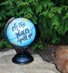 This hand lettered globe would make a great addition to any home! Featuring the phrase oh, the places youll go! in black oil based paint. This inspiring