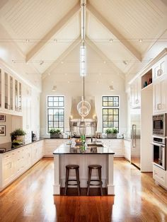Wow, vaulted ceiling in my kitchen! That would be amazing. We recently did a house with this same design concept - white cabinets with the dark marble. It looked incredible!