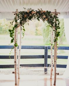 Jeff built the ceremony arbor out of birch trees he found chopped down on the side of the road and embellished it with vintage windows. Sweet Woodruff made the lush floral garland that topped the ceremony backdrop.