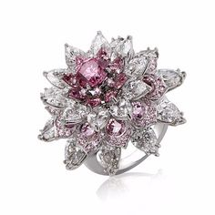 Nirav Modi Shalimar Ring. Designed as a lotus, centering upon a magnificent 1.25 carat fancy vivid purplish pink brilliant-cut diamond, this ring is embellished with a resplendent combination of pears and brilliant-cut diamonds and argyle purplish pink diamonds weighing over 4 carats.