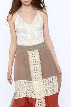632265abe23 Sexy and alluring sleeveless beige crochet bodysuit with a v-neckline and  non-adjustable