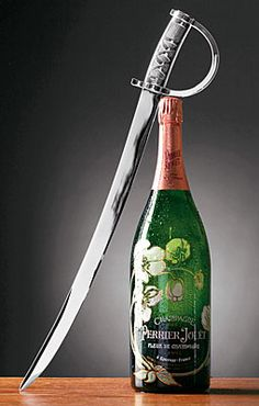 How to open a bottle of champagne with a sword via Mr.Glitterati #thesocialnewyear