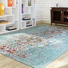 Found it at AllModern - Artemis Aqua Area Rug option for layered family room rug