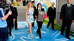 Former Spanish international Carles Puyol and model Gisele Bundchen walk in the tunnel to present the World Cup in a Louis Vuitton travel case