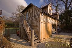 Oak Garages & Outbuildings - 877: Timber garage with office space. Rustic external oak staircase gives access to upper floors.