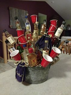 Crown Royal is featured in this alcohol bouquet with Solo … Great gift for a guy! Crown Royal is featured in this alcohol bouquet with Solo cup shot glasses. Alcohol Gift Baskets, Liquor Gift Baskets, Themed Gift Baskets, Raffle Baskets, Diy Gift Baskets, Alcohol Gifts For Men, Fundraiser Baskets, Alcohol Bouquet, Liquor Bouquet