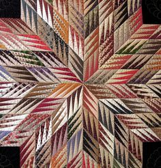 Detail, Fractured Star by Linda Bergmann, made with civil war reproduction fabrics. Photo by Quilt Inspiration.