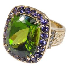 24.0 carat Pakistani Peridot & Purple Sapphire Ring | From a unique collection of vintage cocktail rings at https://www.1stdibs.com/jewelry/rings/cocktail-rings/