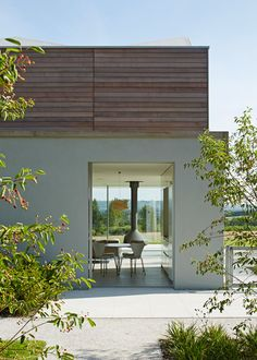 Sussex House by Wilkinson King Architects boasts cedar-clad walls and a ridged roof.